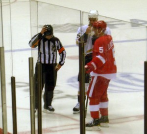 Two captains talking to an official